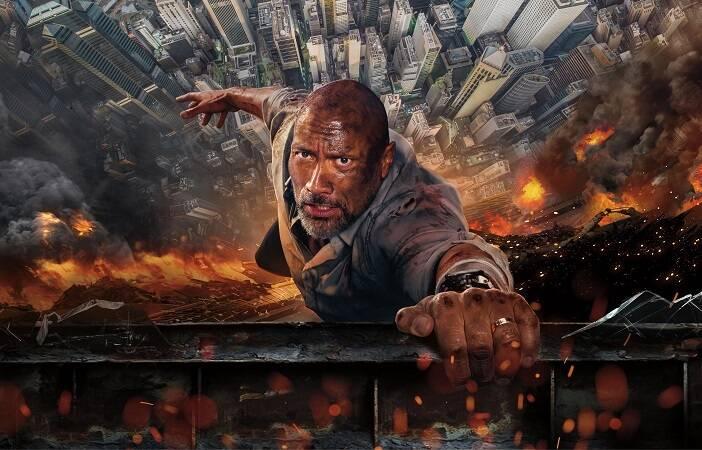 """""""Arranha-Céu: Coragem Sem Limite"""" - Na história, Will Sawyer é um veterano de guerra americano e ex-líder de operações de resgate do FBI. Ele trabalha avaliando a segurança de arranha-céus e, na China, se torna o principal suspeito de colocar o edifício mais alto e seguro de Hong Kong em chamas. (Foto: Divulgação)"""